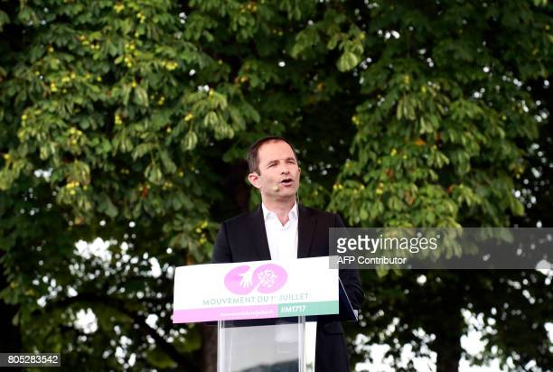 French Socialist member Benoit Hamon delivers a speech during a rally for the launch of his movement 'mouvement du 1er juillet' in Reuilly on July 1...