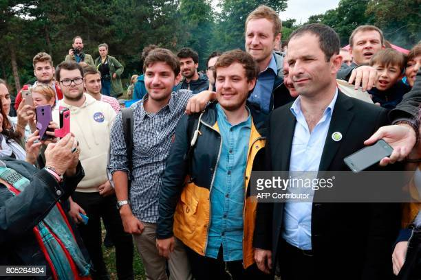 French Socialist member Benoit Hamon poses for pictures as he arrives for the launch of his new movement aimed to renovate the leftwing in Reuilly on...