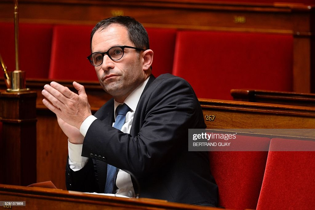 French socialist MP Benoit Hamon applauds during a debate on the controversial labour reform bill at the French National Assembly in Paris, on May 4, 2016. French government says the bill is designed to unlock France's rigid labour market and cut stubbornly high unemployment of around 10 percent -- the issue that has dogged Socialist President Francois Hollande's four years in power.