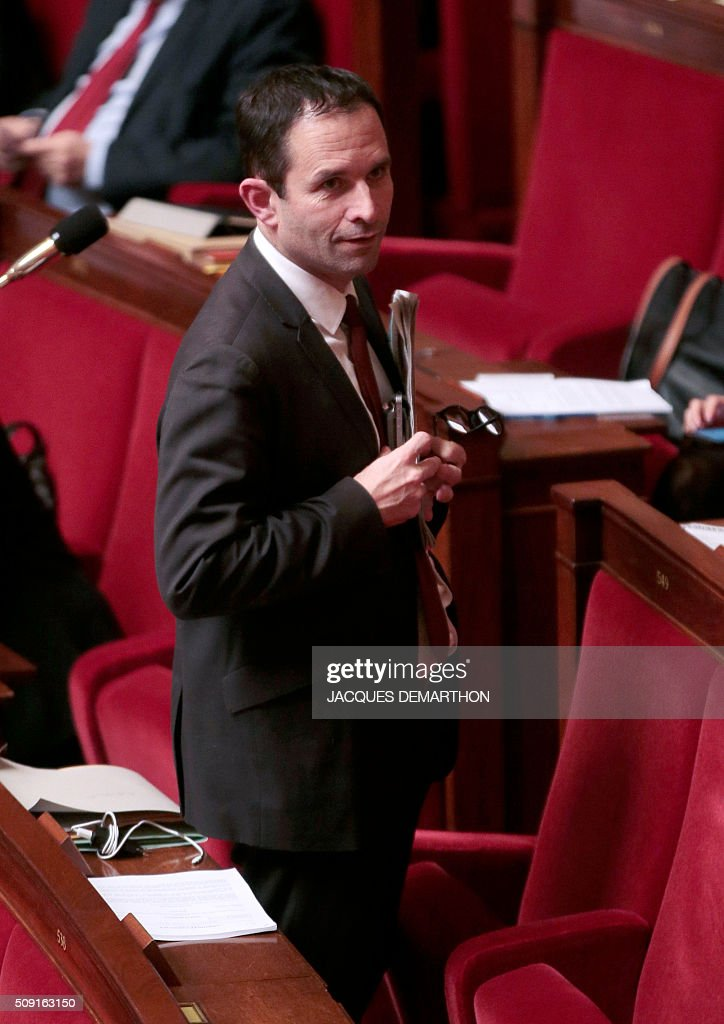 French Socialist MP Benoit Hamon arrives at the French National Assembly in Paris on February 9, 2016, as French lawmakers examined proposed changes to the constitution. France's lower house of parliament is to vote on plans to enshrine a state of emergency into the constitution, including a controversial measure to strip French nationality from those convicted of terrorism and serious crimes. / AFP / JACQUES DEMARTHON