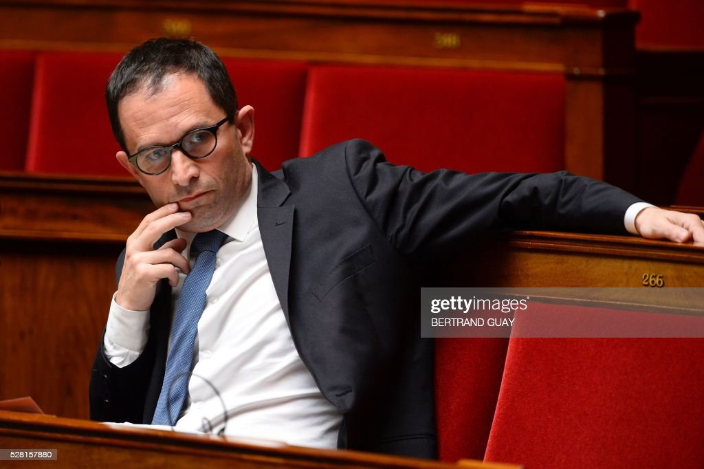 French socialist MP Benoit Hamon attends a debate on the controversial labour reform bill at the French National Assembly in Paris, on May 4, 2016. French government says the bill is designed to unlock France's rigid labour market and cut stubbornly high unemployment of around 10 percent -- the issue that has dogged Socialist President Francois Hollande's four years in power.