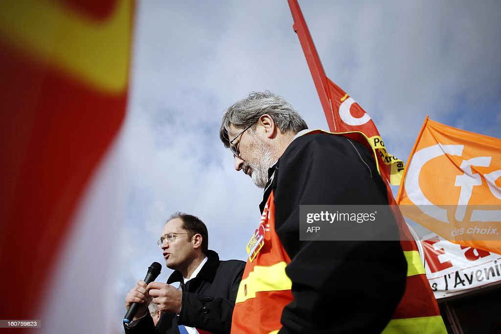 French socialist (PS) MP Guillaume Bacheley (L) talks to Petroplus oil refinery workers next to French Yvon Scornet (R°), unions' spokeman of the Petroplus oil refinery, during a protest outside the Petroplus oil refinery, on February 5, 2013 in Petit-Couronne, northwestern France. A French court ordered last October the liquidation of Petit-Couronne oil refinery despite two offers for the site that employs 470 people. Investors have until this evening to make bids for the business, and the Minister for Industrial Regeneration Arnaud Montebourg said on RTL radio early in the day that the government expected several offers.