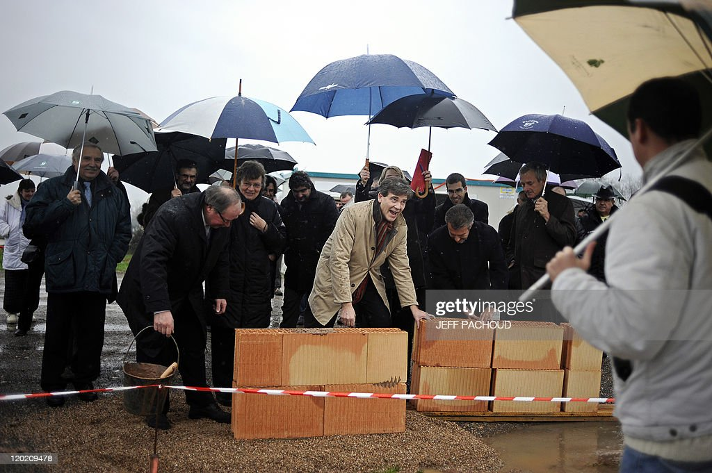 French socialist MP, one of the French Socialist Party (PS) leaders and candidate in the PS 2012 primary election, Arnaud Montebourg (C), 48, lays the first stone of a medical center, in Gueugnon, central eastern France, on December 6, 2010. during a visit in his district. Montebourg is the head of Saone-et-Loire district.