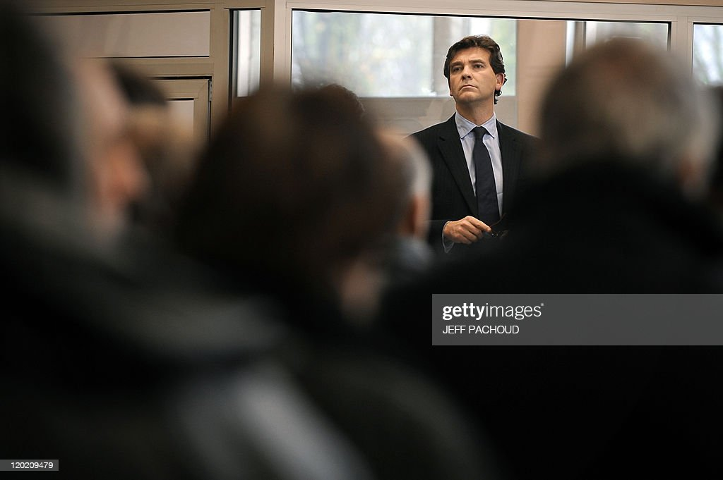 French socialist MP, one of the French Socialist Party (PS) leaders and candidate in the PS 2012 primary election, Arnaud Montebourg, 48, listens to a speech on December 6, 2010 in Gueugnon, central eastern France, during a visit in his district. Montebourg is the head of Saone-et-Loire district. AFP PHOTO / JEFF PACHOUD