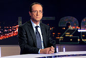 French socialist party candidate for the French 2012 presidential election Francois Hollande poses prior to take part in the broadcast news of French...