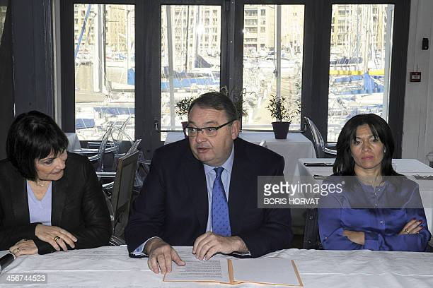 French Socialist Party deputy and candidate for the 2014 mayoral election in Marseille Patrick Mennucci next to Junior Minister for Disabled People...