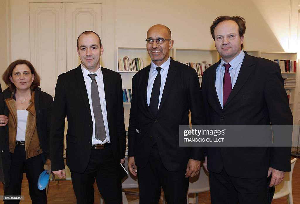 French Socialist Party (PS) first Secretary Harlem Desir (C) poses, surrounded by newly appointed general secretary of French labour union CFDT, Laurent Berger (L) and the PS's national secretary for labour and employment, Jean-Marc Germain (R), on January 14, 2013 prior to a meeting at the PS headquarters in Paris. AFP PHOTO FRANCOIS GUILLOT