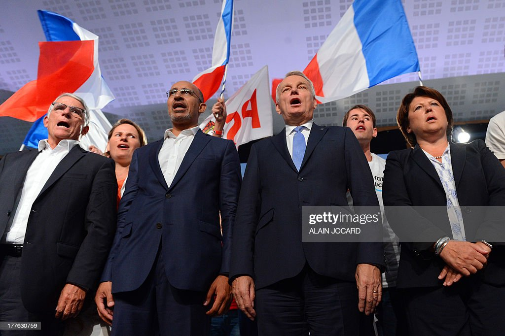 French socialist party first secretary Harlem Desir (2ndL), Toulouse's mayor Pierre Cohen (L), French Prime minister Jean-Marc Ayrault (2ndR) and Lille's mayor Martine Aubry (R) sing the national anthem at the end of the closing session of the 'Universite d'ete', the PS summer congress, on August 25, 2013 in the Atlantic coastal city of La Rochelle. AFP PHOTO / ALAIN JOCARD