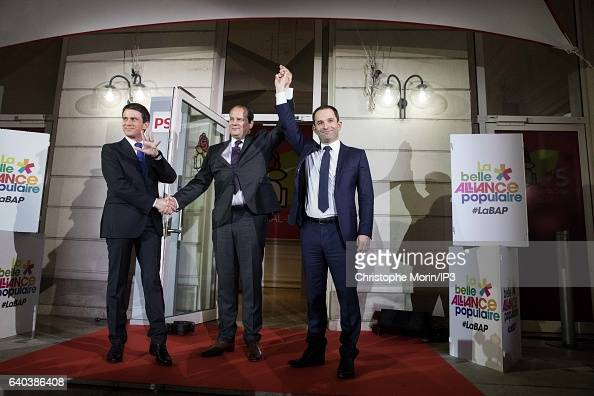 French Socialist Party First Secretary JeanChristophe Cambdelis greets both candidates for the 2017 French Presidential Election Benoit Hamon and...