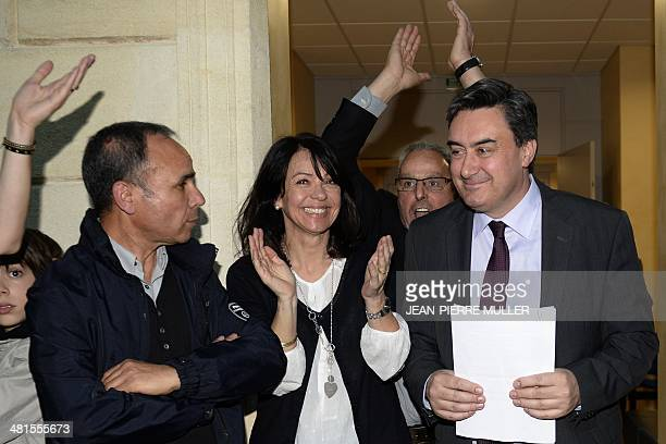 French socialist Party incumbent mayor of VilleneuvesurLot Patrick Cassany celebrates with his supporters after winning the vote on the day of the...