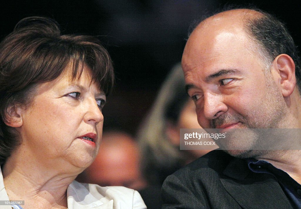 French Socialist party leader Martine Aubry speaks with French Socialist party national secretary and deputy Pierre Moscovici at the French Socialist Party national convention, dedicated to a 'new model of development' project headed by Moscovici, on May 29, 2010 in La plaine Saint Denis, outside Paris. Aubry said today that 'real work begins' for the 2012 presidential election.