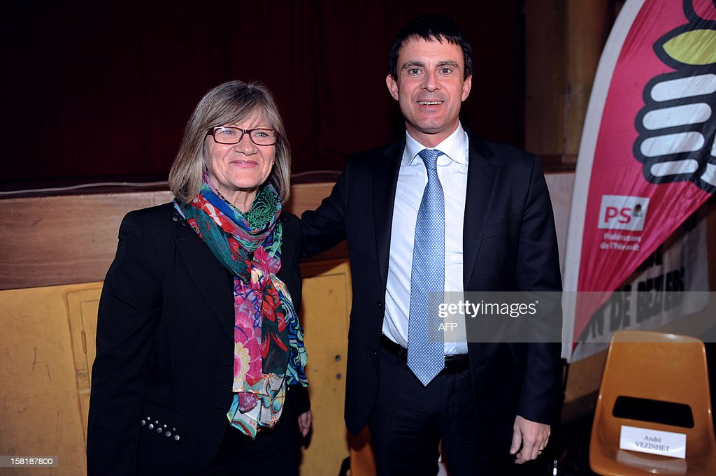 French Socialist Party (PS) member of Parliament, Dolores Roque (L), poses beside French Interior Minister Manuel Valls, during a campaign meeting on December 10, 2012 in Beziers, southern France, as she runs for her reelection in the Herault's 6th constituency at the French Parliamentary elections second-round next December 12. The French Constitutional Council cancelled her election of last June 17, due to 23 irregular proxy vote forms.