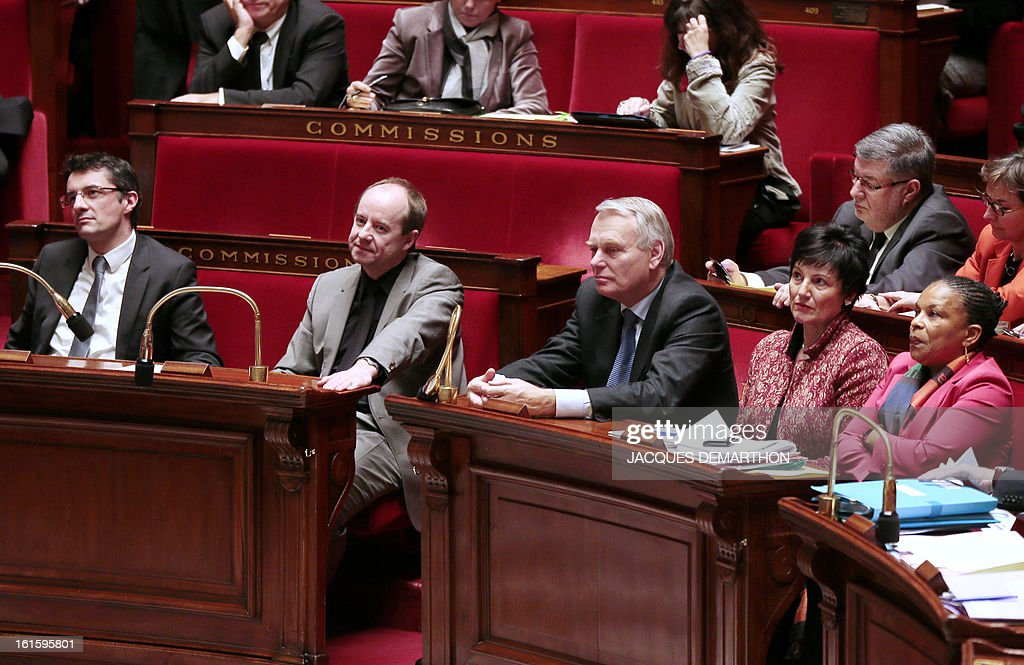 French Socialist Party (PS) MP and Rapporteur of the law allowing homosexual couples to marry and adopt children, Erwann Binet, the President of the law committee of the National Assembly Jean-Jacques Urvoas, French Prime Minister Jean-Marc Ayrault, French Junior Minister for Family Dominique Bertinotti and French Justice Minister Christiane Taubira listen on February 12, 2013 at the French National Assembly in Paris, during the vote legalising same-sex marriage. The assembly voted by a clear majority to adopt legislation allowing homosexual couples to marry and adopt children. The formal vote came 10 days after lawmakers voted overwhelmingly in favour of its key article which redefines marriage as a contract between two people rather than between a man and a woman. The law will now go for approval by the upper house of parliament.
