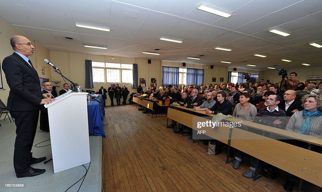 French Socialist Party (PS) national secretary Harlem Desir (L) addresses during a meeting with PS militants on April 5, 2013 in Limoges, central France.