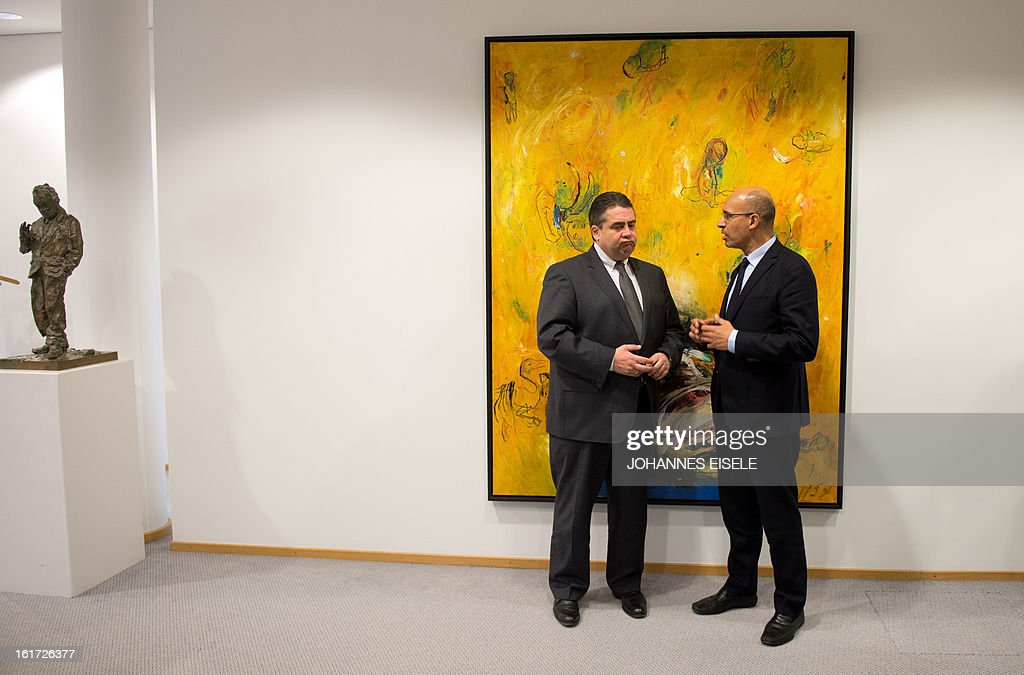 French Socialist Party (PS) national secretary Harlem Desir and Chairman of German social democratic party SPD Sigmar Gabriel pose for a photo on February 14, 2013 in Berlin.
