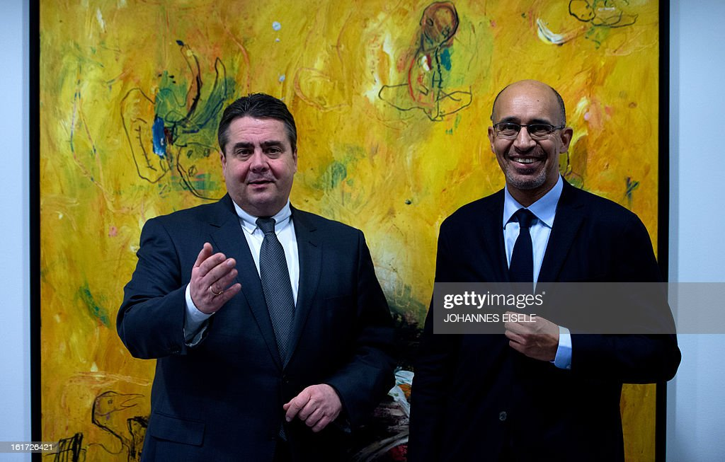 French Socialist Party (PS) national secretary Harlem Desir (R) and Chairman of German social democratic party SPD Sigmar Gabriel pose for a photo on February 14, 2013 in Berlin.