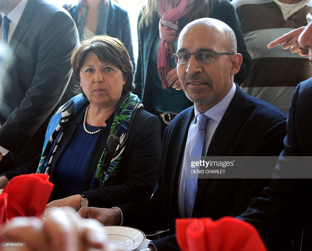 French Socialist Party (PS) national Secretary Harlem Desir (R) and Lille's Mayor and former minister Martine Aubry (L) arrive to attend a socialist meeting and lunch, the 'Fete de la rose' in Tourcoing, northern France, on May, 1, 2013, as part of the May Day events. AFP PHOTO DENIS CHARLET