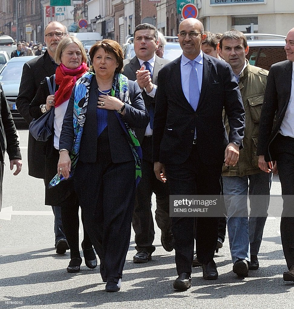 French Socialist Party (PS) national Secretary Harlem Desir (R) and Lille's Mayor and former minister Martine Aubry (L) arrive to attend a socialist meeting and lunch, the 'Fete de la rose' in Tourcoing, northern France, on May, 1, 2013, as part of the May Day events.