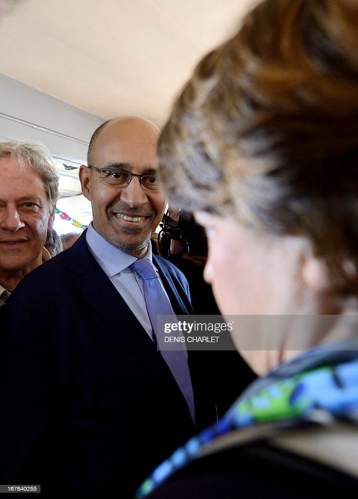 French Socialist Party (PS) national Secretary Harlem Desir (C) and Lille's Mayor and former minister Martine Aubry (R) answer to journalists as they arrive to attend a socialist meeting and lunch, the 'Fete de la rose' in Tourcoing, northern France, on May, 1, 2013, as part of the May Day events.