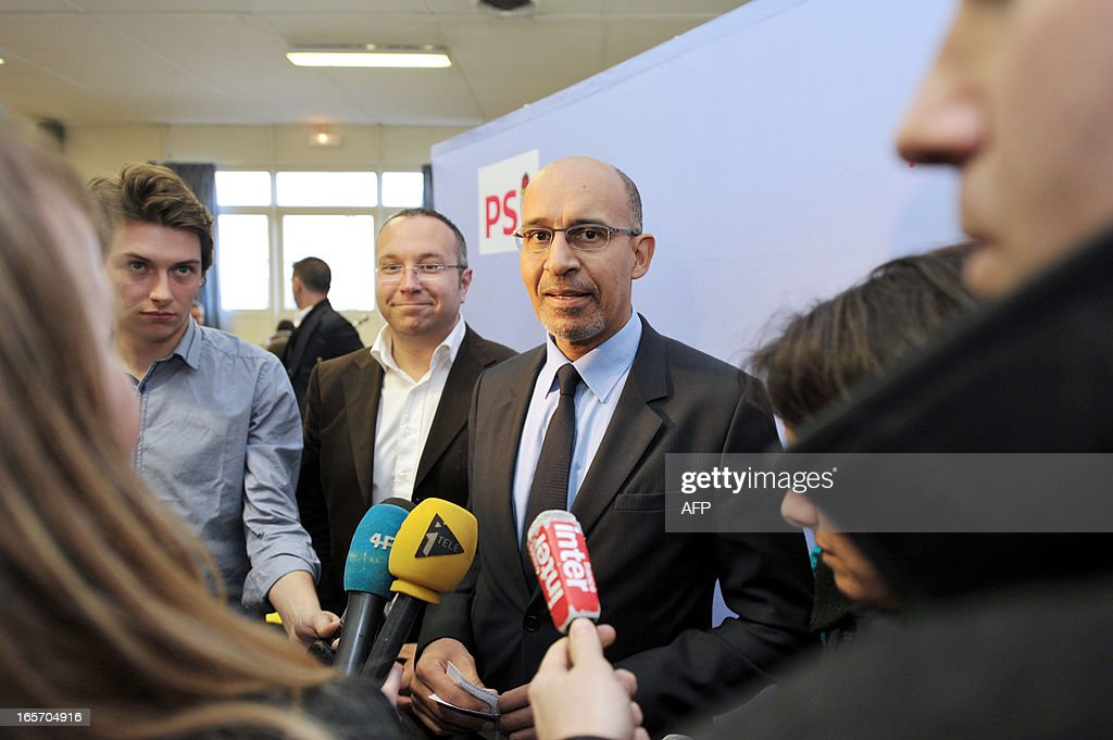 French Socialist Party (PS) national secretary Harlem Desir (C) answers the media beside the PS Haute Vienne first secretary Laurent Lafaye (C,L) during a meeting with PS militants on April 5, 2013 in Limoges, central France. AFP PHOTO / PASCAL LACHENAUD