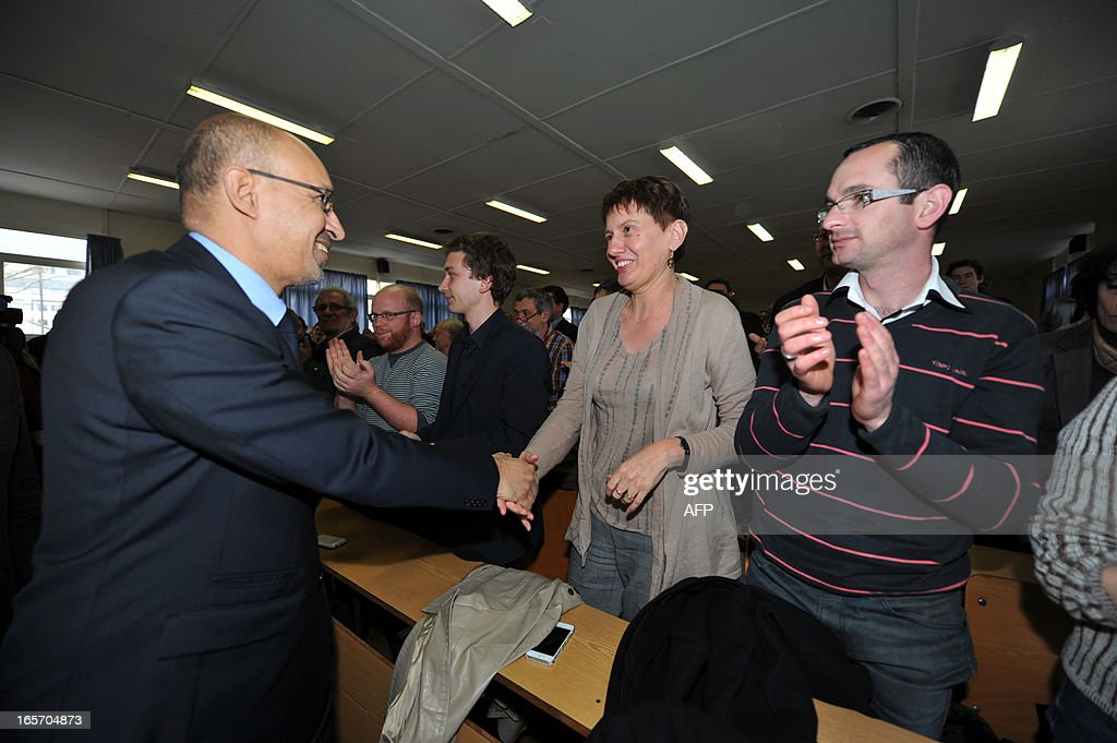 French Socialist Party (PS) national secretary Harlem Desir (L) greets PS militants during a meeting on April 5, 2013 in Limoges, central France. AFP PHOTO / PASCAL LACHENAUD