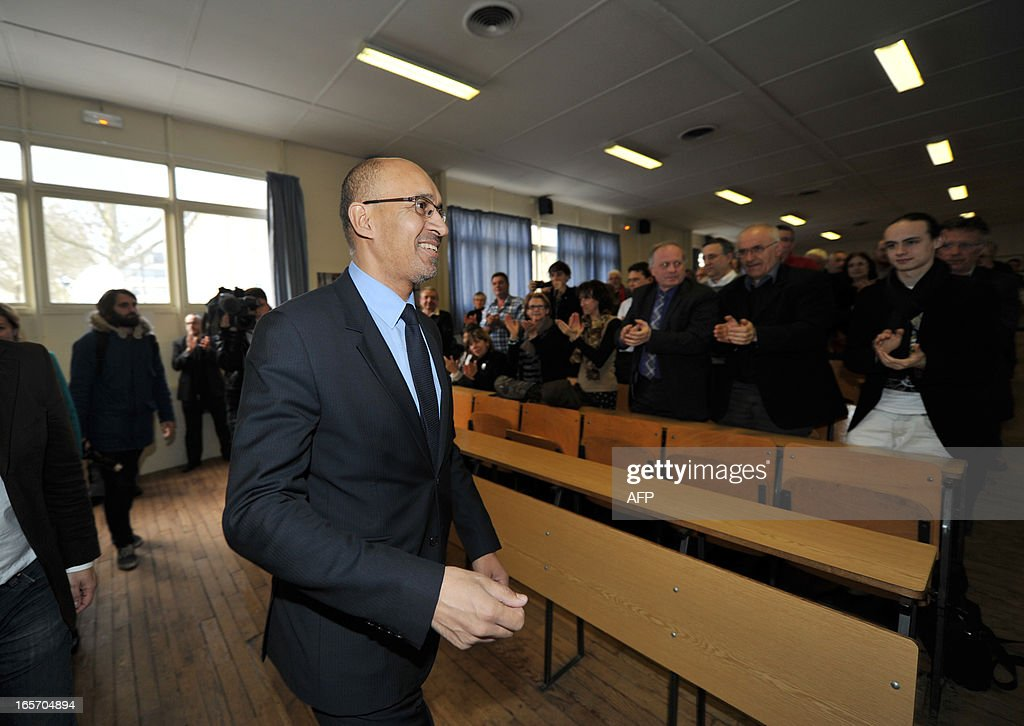 French Socialist Party (PS) national secretary Harlem Desir (C) is greeted by PS militants during a meeting on April 5, 2013 in Limoges, central France.