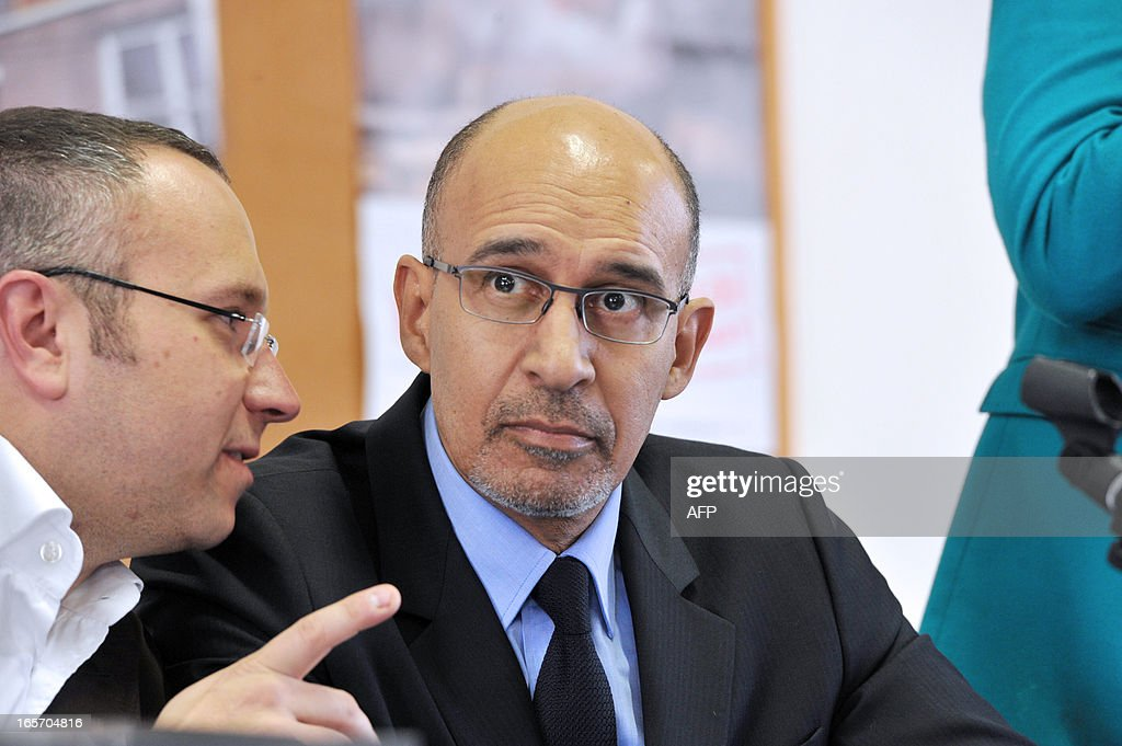 French Socialist Party (PS) national secretary Harlem Desir (R) listens to the PS Haute Vienne first secretary Laurent Lafaye during a meeting with PS militants on April 5, 2013 in Limoges, central France. AFP PHOTO / PASCAL LACHENAUD
