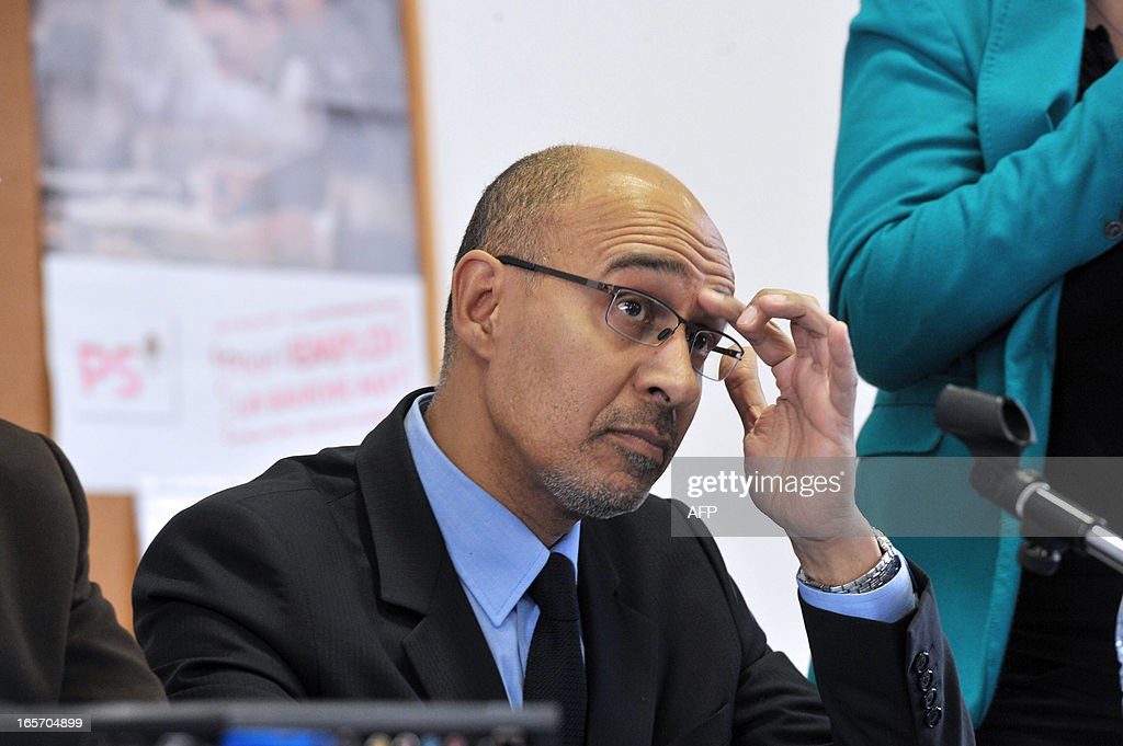 French Socialist Party (PS) national secretary Harlem Desir looks on during a meeting with PS militants on April 5, 2013 in Limoges, central France.
