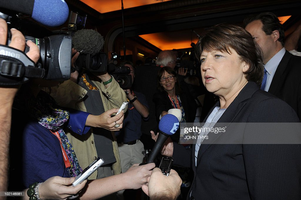 French Socialist Party's Secretary, Martine Aubry (R) answers journalists' questions prior to the Party of European Socialists meeting (PES) in Brussels on June 16, 2010, on the eve of an European Council gathering EU's heads of state.