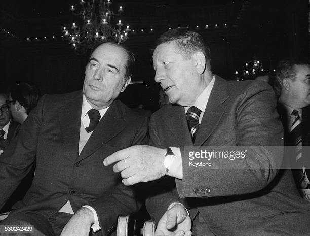 French Socialist politician Francois Mitterand and Italian Communist politician Giorgio Amendola chatting at a conference by the Associated Business...
