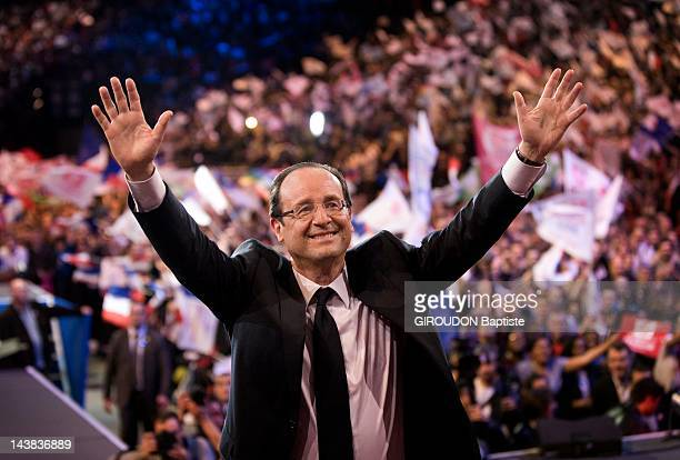 French Socialist presidential candidate Francois Hollande greets supporters at an election campaign rally at the Palais Omnisports ParisBercy on...