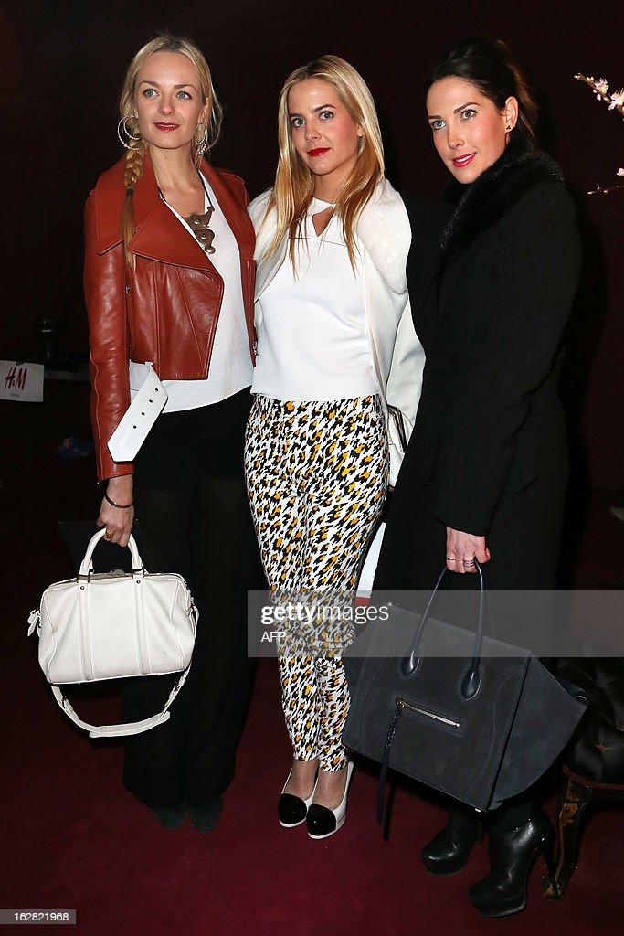 French socialites Virginie CourtinClarins Jenna CourtinClarins and Prisca CourtinClarins pose on February 27 2013 prior to attend the HM collection...