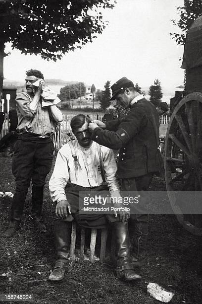 French soldier cutting the hair of one of his comrades during World War I 1910s