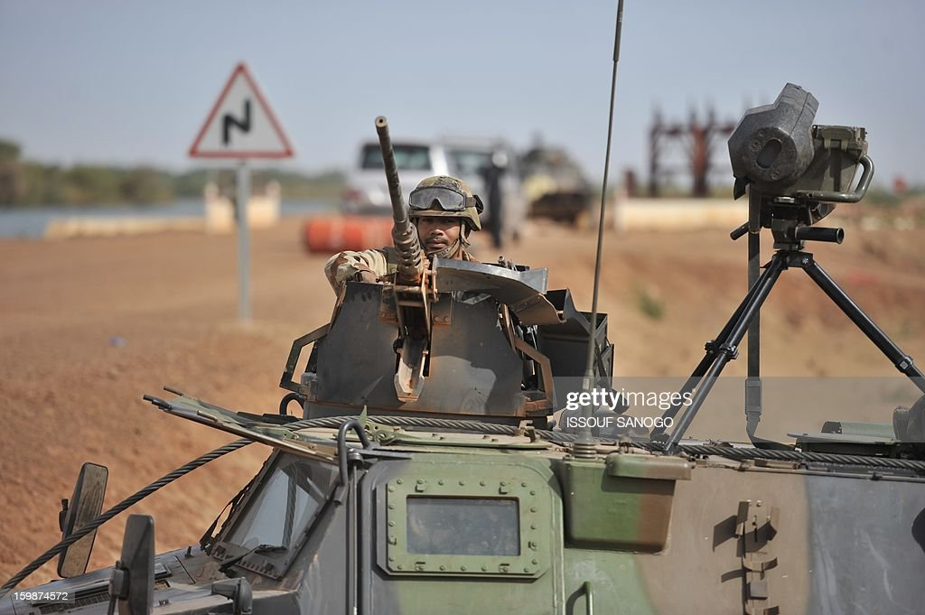 A French soldier deployed near city of Diabaly keeps post from a machine gun mounted vehicle on January 22, 2013. The EU executive Tuesday announced 20 million euros of extra humanitarian aid to help tens of thousands of Malians fleeing fighting in the nation's north and centre, its second such donation in as many months.