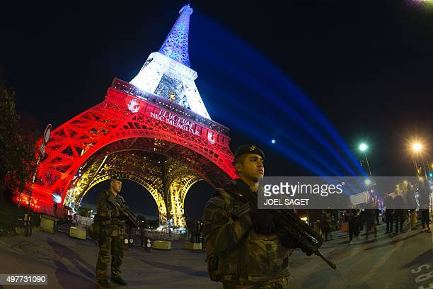 A French soldier enforcing the Vigipirate plan France's national security alert system is pictured on November 18 2015 in Paris in front of the...