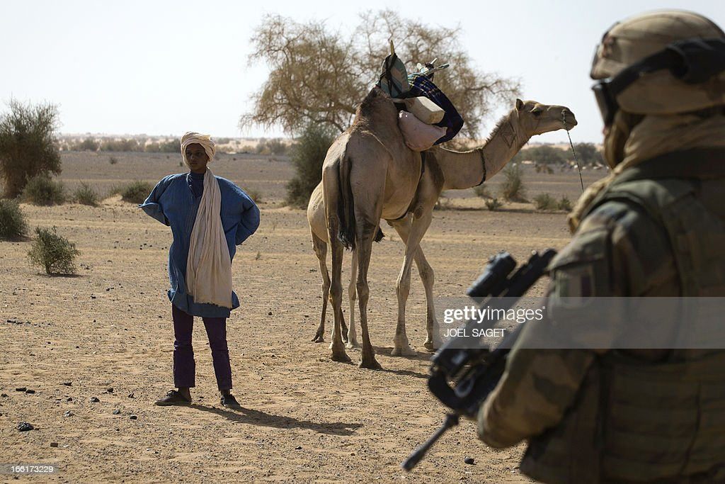 A French soldier from the 126 RI (Regiment Infantery) stands guard during the Operation Gustav, a hunt for Islamist fighters in a valley in northern Mali and one of France's largest military operations during its three-month intervention in its former colony, on April 9, 2013, 105 km North of Gao. Operation Gustav comes with France preparing to withdraw three-quarters of the 4,000 troops it deployed in January to block a feared advance on the Malian capital Bamako by Al Qaeda-linked insurgents.