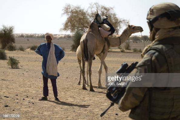 A French soldier from the 126 RI stands guard during the Operation Gustav a hunt for Islamist fighters in a valley in northern Mali and one of...