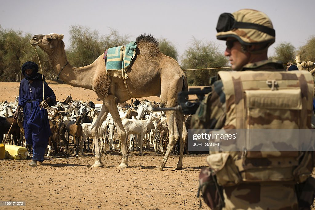 French soldier from the 126 RI stands guard near a well during the Operation Gustav, a hunt for Islamist fighters in a valley in northern Mali and one of France's largest military operations during its three-month intervention in its former colony, on April 9, 2013, 105 km North of Gao. Operation Gustav comes with France preparing to withdraw three-quarters of the 4,000 troops it deployed in January to block a feared advance on the Malian capital Bamako by Al Qaeda-linked insurgents.