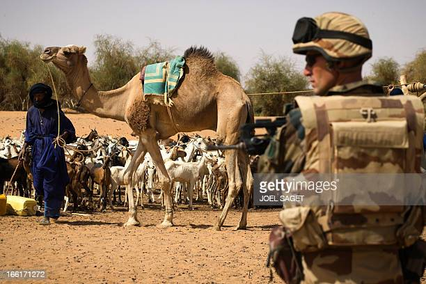 French soldier from the 126 RI stands guard near a well during the Operation Gustav a hunt for Islamist fighters in a valley in northern Mali and one...