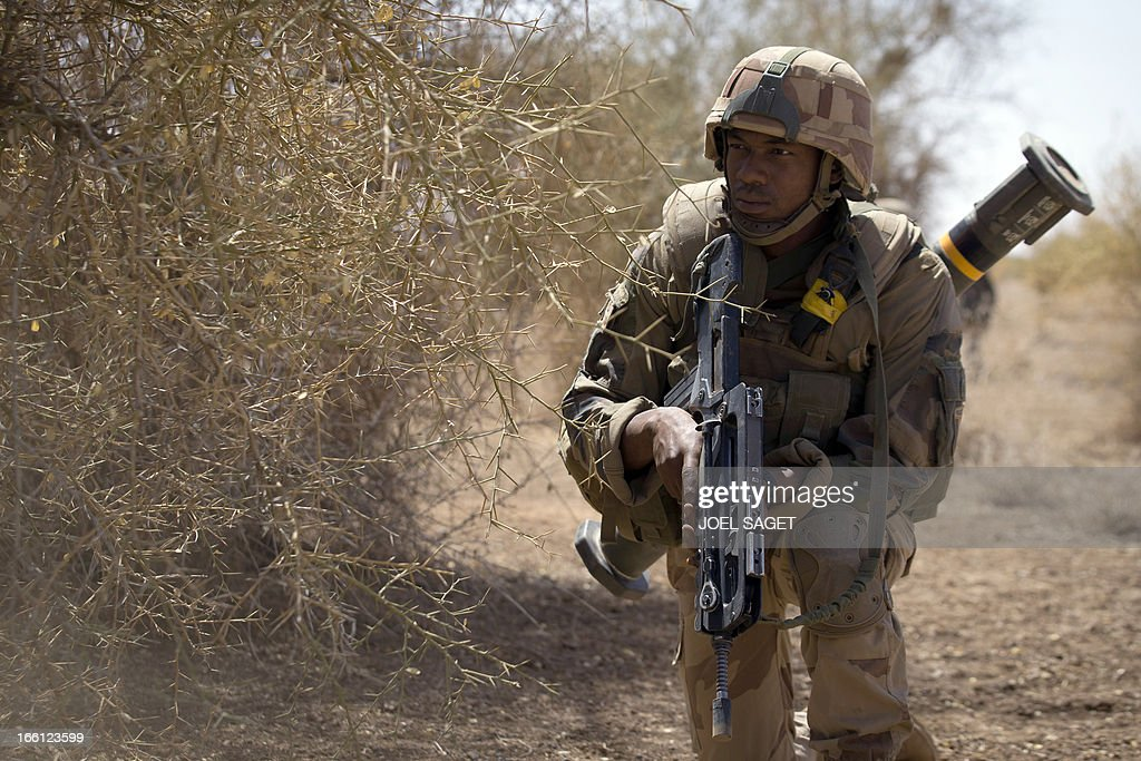 A French soldier from the 92nd Regiment Infantery takes part in a military operation on April 8, 2013 some 105 kilometers North of Gao. A French force of 1,000 soldiers in a major offensive has swept a valley thought to be a logistics base for Al-Qaeda-linked Islamists near the Malian city of Gao. Operation Gustav, one of France's largest actions since its intervention against insurgents in January, will involve dozens of tanks, helicopters, drones and airplanes, said General Bernard Barrera, commander of the French land forces in Mali. France is to start withdrawing its 4,000 troops from Mali at the end of April, and plans to leave a 'support force' of 1,000 soldiers after elections promised for July. AFP PHOTO / JOEL SAGET