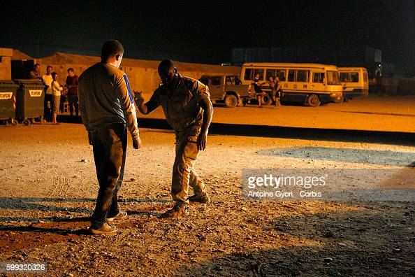 A French soldier from the Special Forces Unit trains a colleague at night on the Kandahar military base During the last NATO summit in April French...