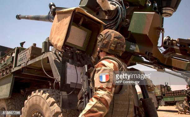 A French soldier from the Wagram Task Force checks a unit of CAESAR a French selfpropelled 155 mm howitzer north of Mosul on July 13 as the French...