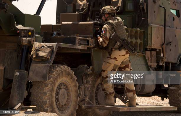 A French soldier from the Wagram Task Force stands next to a unit of CAESAR a French selfpropelled 155 mm howitzer north of Mosul on July 13 as the...