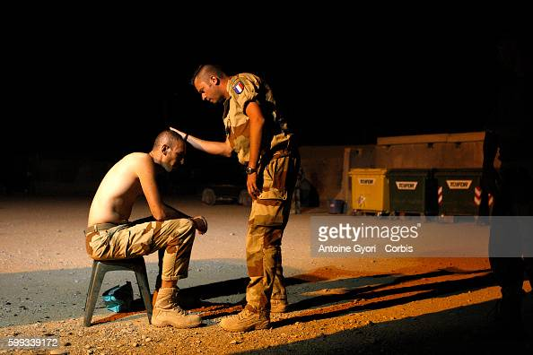 A French soldier gets a haircut at night on the Kandahar military base During the last NATO summit in April French President Nicolas Sarkozy...