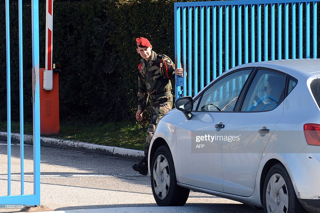 A French soldier guards on March 3, 2013 in Pamiers, southwestern France, the entrance of the 1st Parachute Chasseur Regiment barracks (RCP), an airbone infantry unit of the French Army, where the French soldier killed in northern Mali on March 2 was based. France said on March 3 that one of its soldiers had been killed in fighting in northern Mali, in the third death of a French serviceman since the launch of its military intervention in mid-January. The defence ministry identified the soldier as Corporal Cedric Charenton, 26, who had been deployed in Mali since January 25 and had previously served in Afghanistan and Gabon.