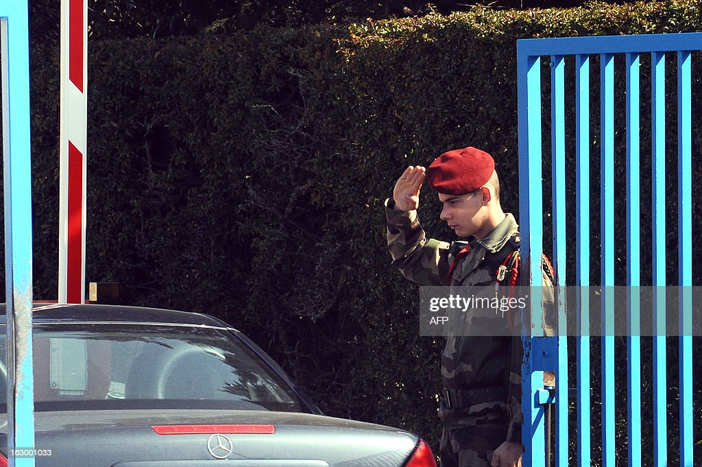 A French soldier guards on March 3, 2013 in Pamiers, southwestern France, the entrance of the 1st Parachute Chasseur Regiment barracks (RCP), an airbone infantry unit of the French Army, where the French soldier killed in northern Mali on March 2 was based. France said on March 3 that one of its soldiers had been killed in fighting in northern Mali, in the third death of a French serviceman since the launch of its military intervention in mid-January. The defence ministry identified the soldier as Corporal Cedric Charenton, 26, who had been deployed in Mali since January 25 and had previously served in Afghanistan and Gabon. AFP PHOTO /REMY GABALDA