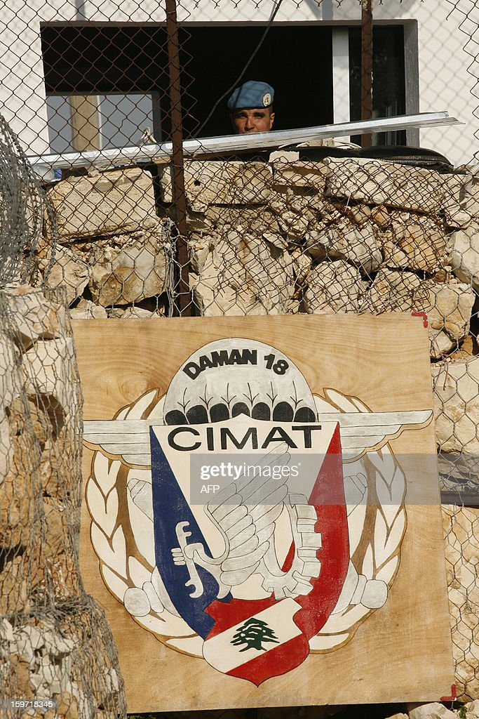 A French soldier is seen behing the logo of the CIMAT, (Theater Maintenance Company /Direct Support) at the United Nations Interim Force in Lebanon (UNIFIL) French base on January 19, 2013 in the southern city of Deir Kifa.