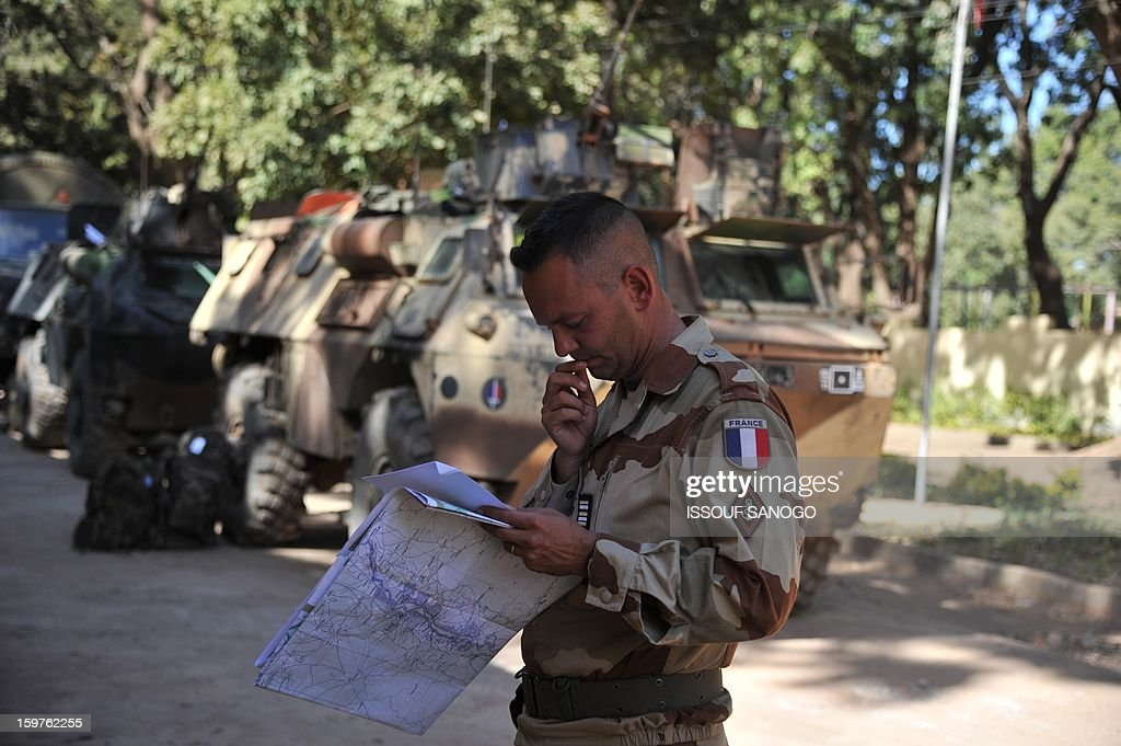 A French soldier looks at a map on January 20, 2013 in the city of Niono, about 350 kms (220 miles) northeast of the capital Bamako and 60 kms south of Diabaly, which was seized on January 14 by Islamists and then heavily bombed by French warplanes. A spokesman for the French military operation codenamed Serval said on January 20 that French forces were advancing towards Mali's Islamist-held north after taking up positions in the towns of Niono and Sevare. SANOGO