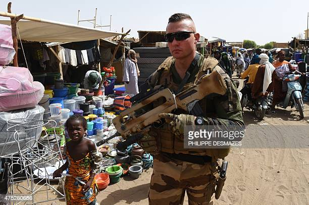 A French soldier of Operation Barkhane an antiterrorist operation in the Sahel patrols at a market in Gao northern Mali on May 30 2015 Based in...