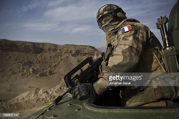French soldier of the 2nd Regiment Engineers of the Foreign Legion attached to the 27 me Bataillon de Chasseurs Alpins of the French Army watches the...
